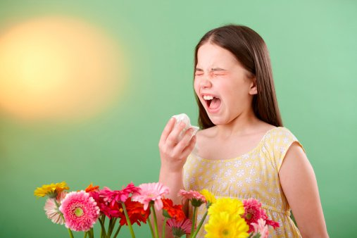 Girl with flowers sneezing